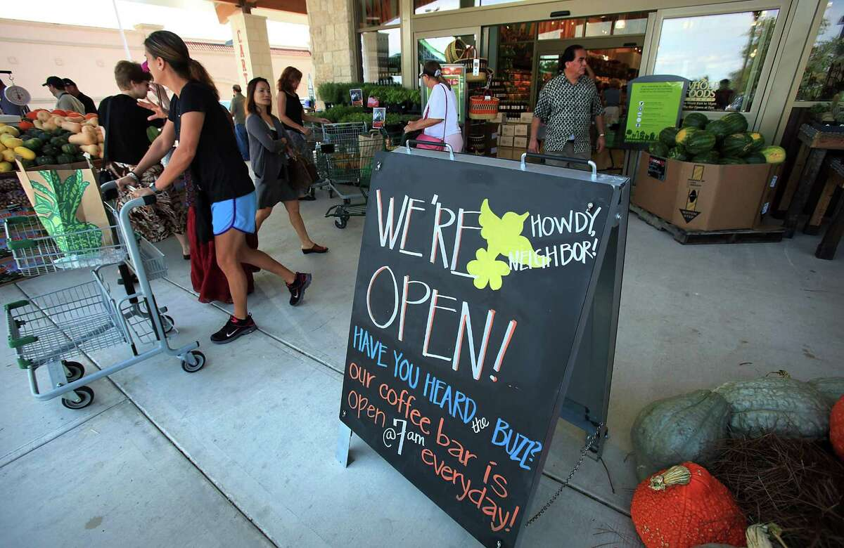 """Shoppers depart and arrive at the new Whole Foods Market grand opening at 18403 Blanco, Tuesday, Sept. 18, 2012. The online grocery wars heated up with Seattle-based Amazon on Tuesday expanding its """"Prime Now"""" delivery of Whole Foods Market products to San Antonio, Houston, Chicago, Indianapolis and Minneapolis."""