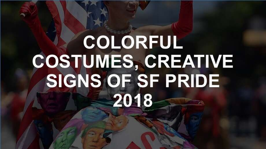 Click through the slideshow to explore some of the most vibrant costumes and unique signs of SF's 2018 Pride Festival. Photo: Josh Edelson/AFP/Getty Images