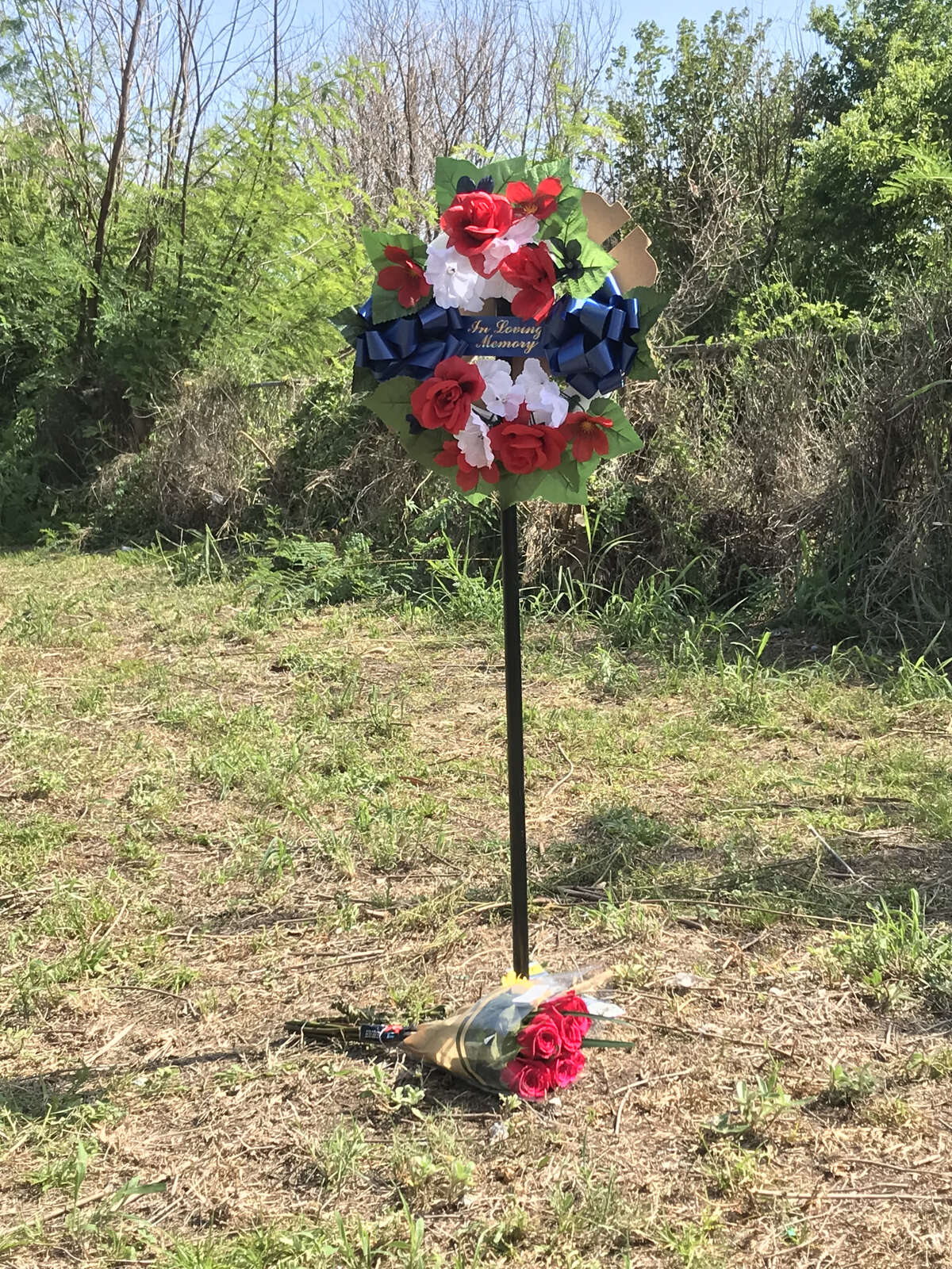 Neighbors placed a wreath in a vacant lot on Avenue L where 18-year-old Luis Argueta was shot by a Galveston police officer following a traffic stop in the early-morning hours of June 25, 2018. Police have released few details about the shooting.