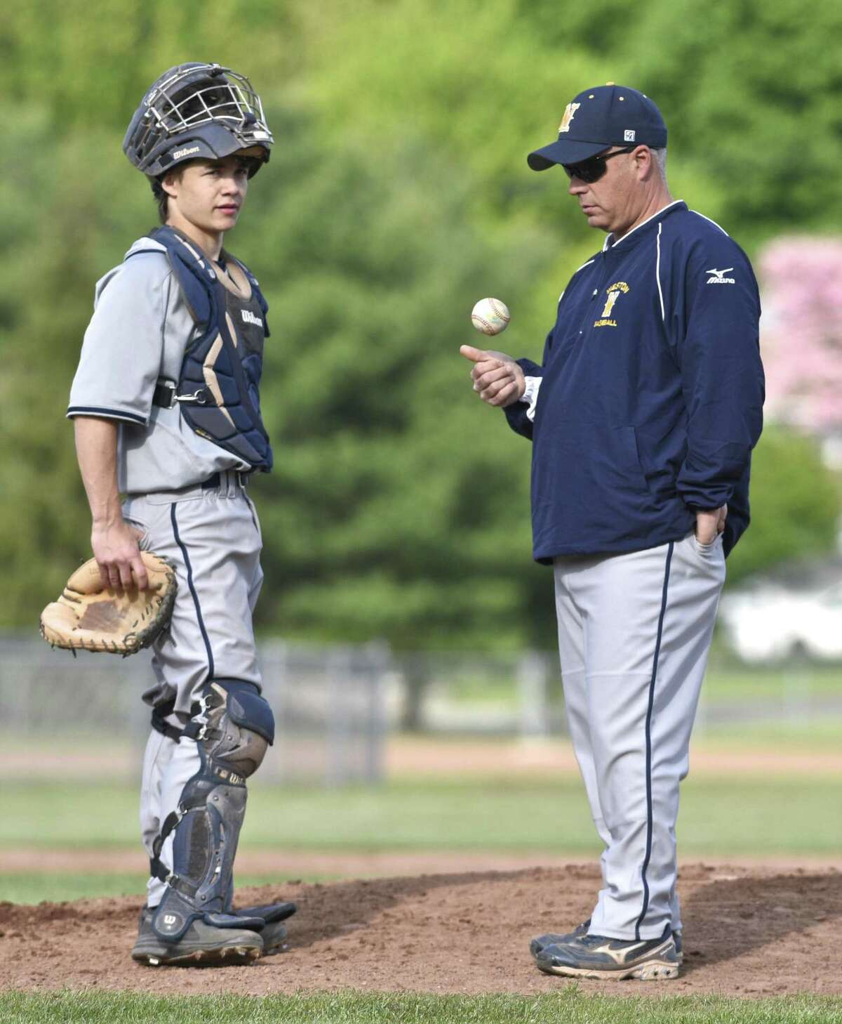 Weston head coach Frank Fedeli and catcher Jake Cavicchia (10) wait on the mound for a new pitcher to enter the game during the boys baseball game between Weston and New Milford high schools. Wednesday afternoon, May 10, 2017, at New Milford High School, in New Milford, Conn.