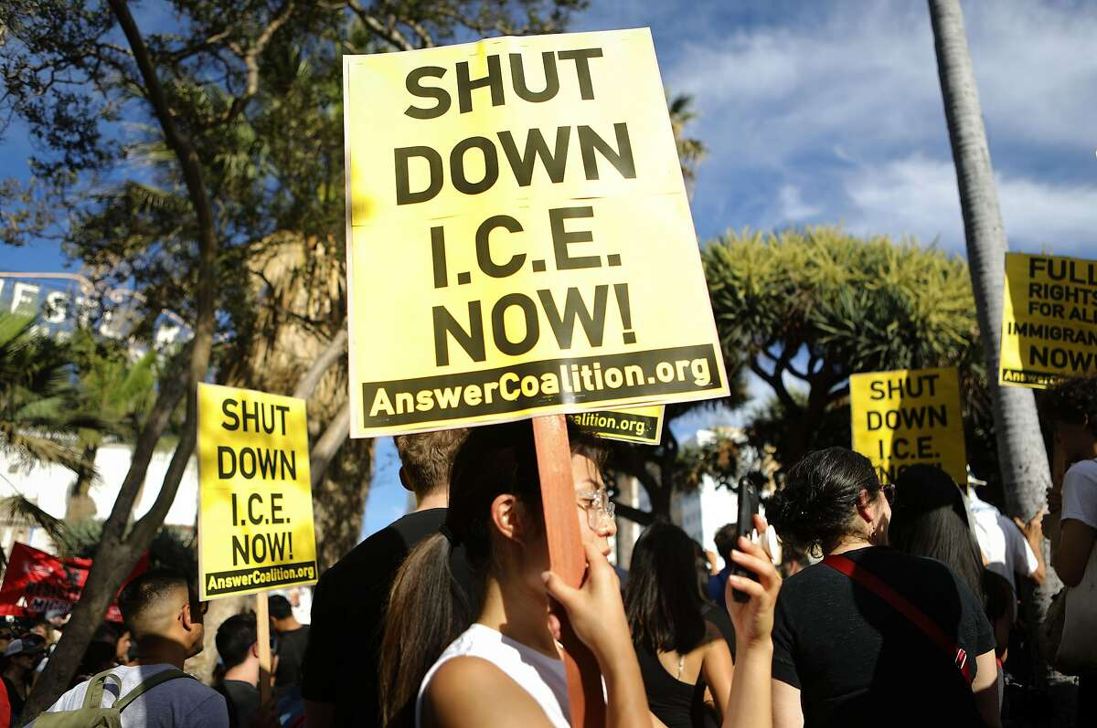 LOS ANGELES, CA - JUNE 14: Protestors gather at the 'Families Belong Together March' against the separation of children of immigrants from their families on June 14, 2018 in Los Angeles, California. Demonstrators marched through the city and culminated the march at a detention center where ICE (U.S.Immigration and Customs Enforcement) detainees are held. U.S. Immigration and Customs Enforcement recently arrested 162 undocumented immigrants during a three-day operation in Los Angeles and surrounding areas. (Photo by Mario Tama/Getty Images)