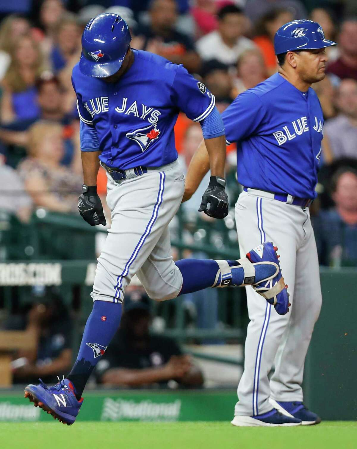 Toronto Blue Jays right fielder Curtis Granderson rounds third after hitting a solo home run off Houston Astros starting pitcher Justin Verlander during the seventh inning of a major league baseball game at Minute Maid Park on Monday, June 25, 2018, in Houston.
