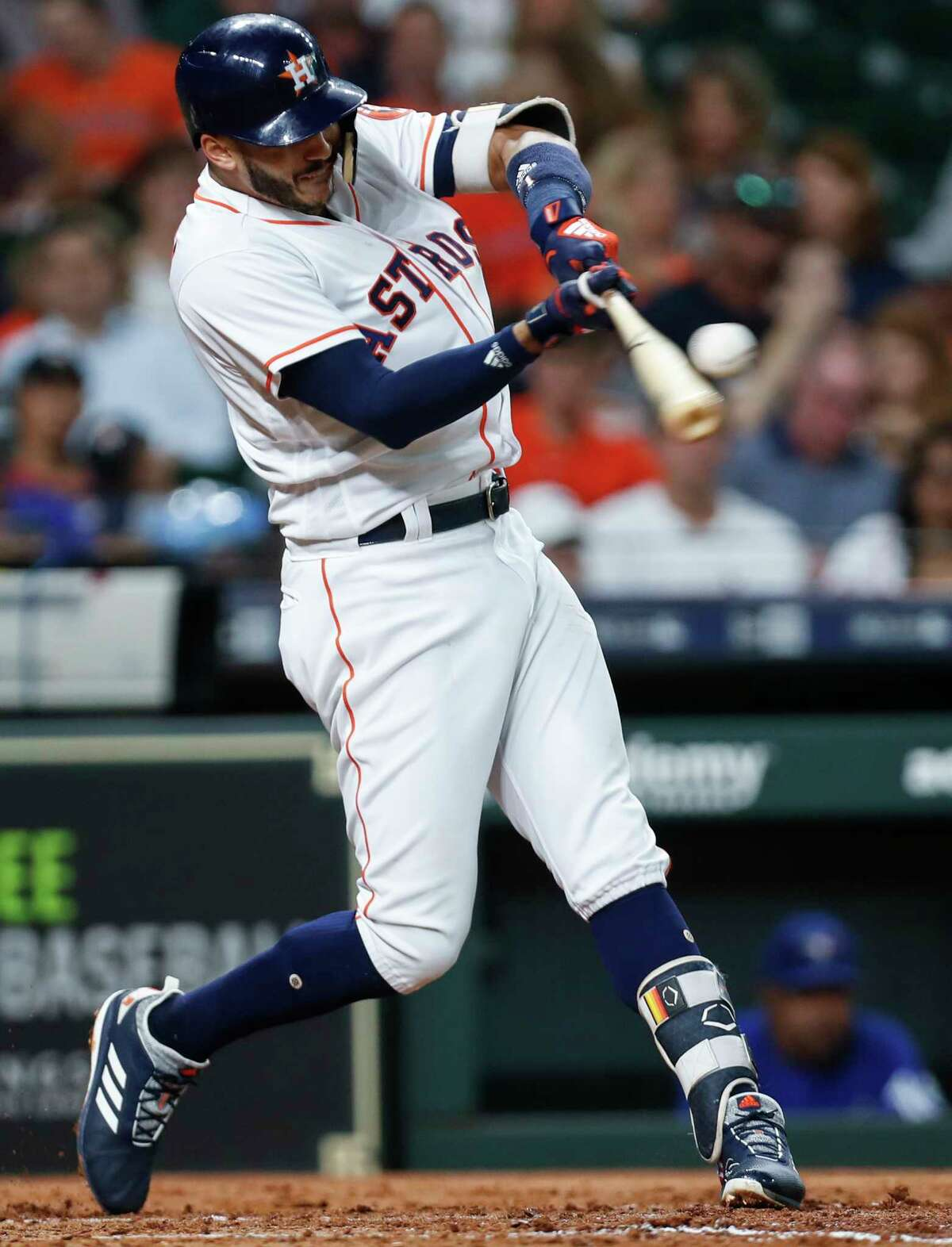 Houston Astros shortstop Carlos Correa singles off of Toronto Blue Jays starting pitcher J.A. Happ during the third inning of a major league baseball game at Minute Maid Park on Monday, June 25, 2018, in Houston.
