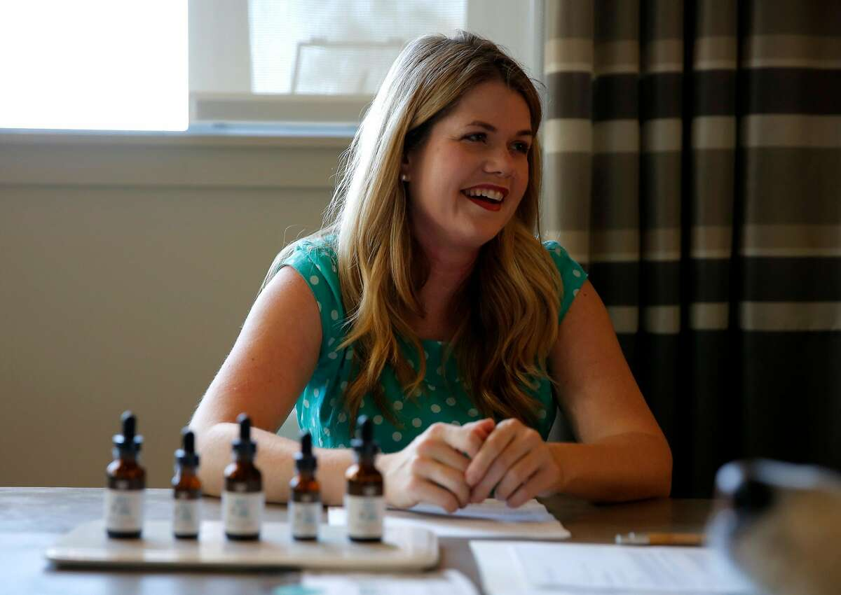 Alison Ettel, CEO and founder of TreatWell, laughs during a consultation at her apartment complex in San Francisco, California, on Sunday, Oct. 18, 2015.