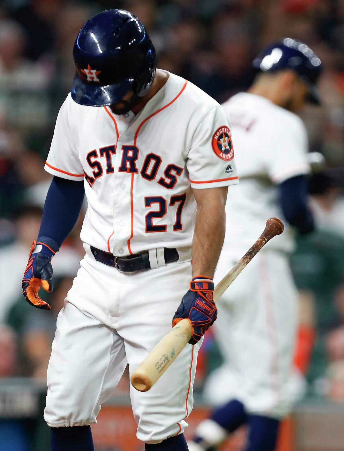 Houston Astros second baseman Jose Altuve (27) walks back to the dugout after he is called out on strikes against the Toronto Blue Jays during the seventh inning of a major league baseball game at Minute Maid Park on Monday, June 25, 2018, in Houston.