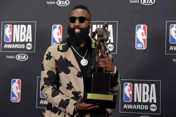 NBA player James Harden, of the Houston Rockets, poses in the press room with the most valuable player award at the NBA Awards on Monday, June 25, 2018, at the Barker Hangar in Santa Monica, Calif. (Photo by Richard Shotwell/Invision/AP)