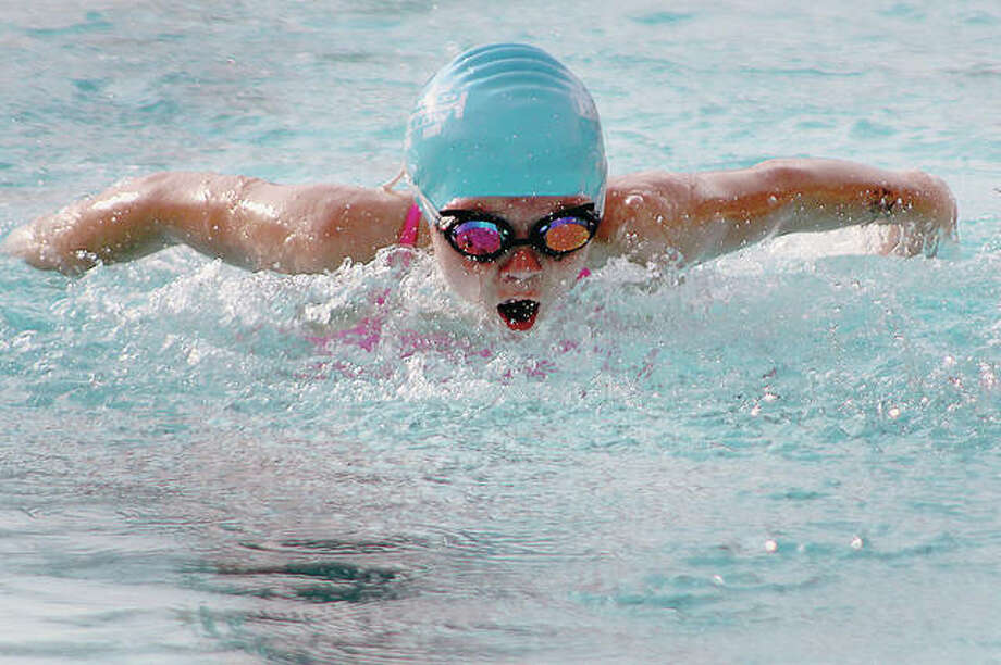 Water Works' Karissa Osborn swims the butterfly in the 9-10 girls 100-yard medley relay Monday at the annual SWISA Relays Meet at Sunset Hills Country Club in Edwardsville. Photo:       Pete Hayes | The Telegraph