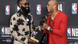 NBA player James Harden, of the Houston Rockets, left, winner of the most valuable player award, appears in the press room with his teammate P.J. Tucker at the NBA Awards on Monday, June 25, 2018, at the Barker Hangar in Santa Monica, Calif. (Photo by Richard Shotwell/Invision/AP)