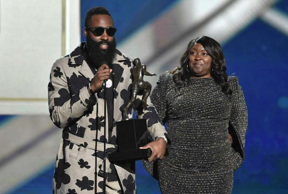 NBA player James Hardin, of the Houston Rockets, left, accepts the most valuable player award as his mother Monja Willis looks on at the NBA Awards on Monday, June 25, 2018, at the Barker Hangar in Santa Monica, Calif. (Photo by Chris Pizzello/Invision/AP) Photo: Chris Pizzello / Invision