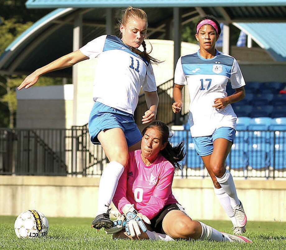 Lewis and Clark Community College's Nina Breuer (11) gets tangled with Lincoln's goalkeeper Amanda Villa (4) during a 2016 game at LCCC. Lincoln has announced that it is moving from the JUCO ranks to become a four-year institution and its athletic teams will compete in the NAIA. Photo:       S. Paige Allen | For The Telegraph