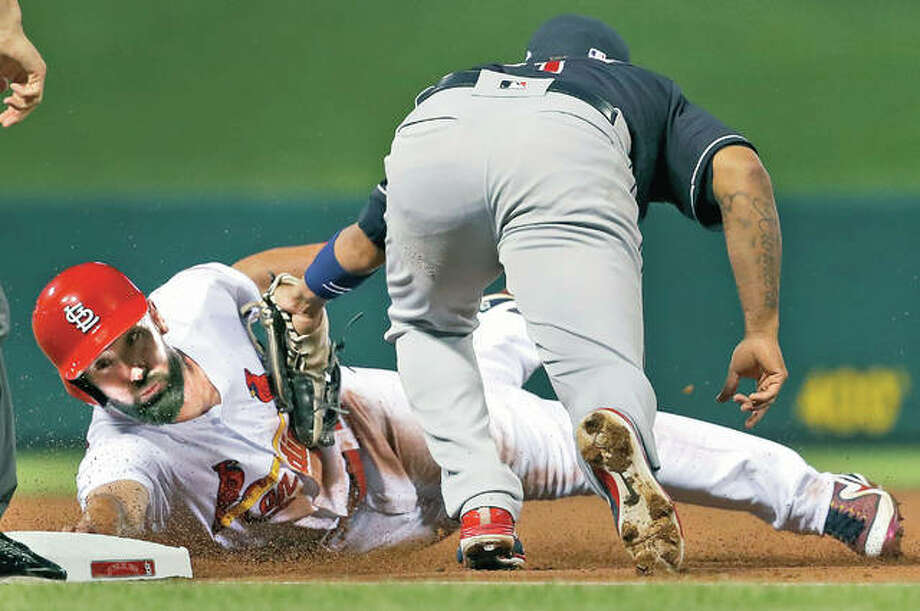 The Cardinals' Matt Carpenter is tagged out by Cleveland Indians third baseman Jose Ramirez, right, while trying to reach third base in the first inning Monday in St. Louis. The Cardinaals won 4-0. Photo:       AP