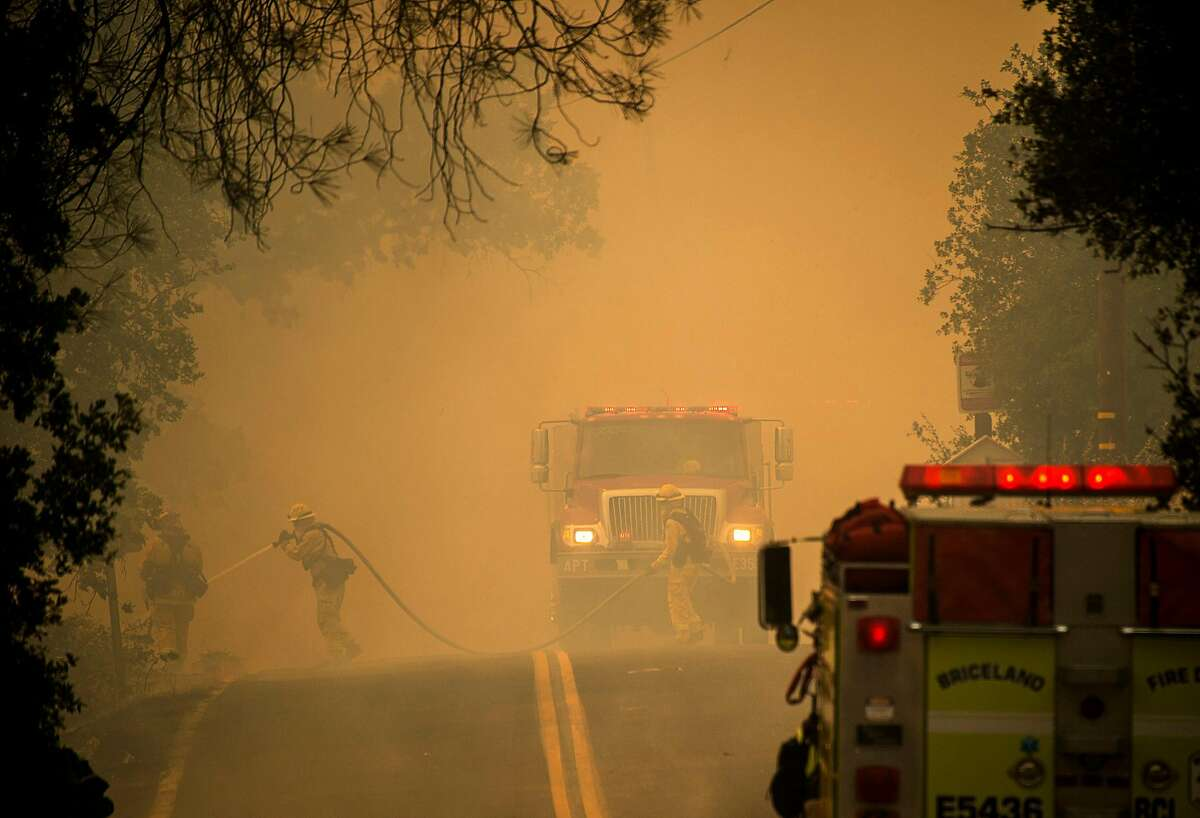 Firefighters work to contain the Pawnee fire on Sunday, June 24, 2018 in Spring Valley in Lake County, Calif.