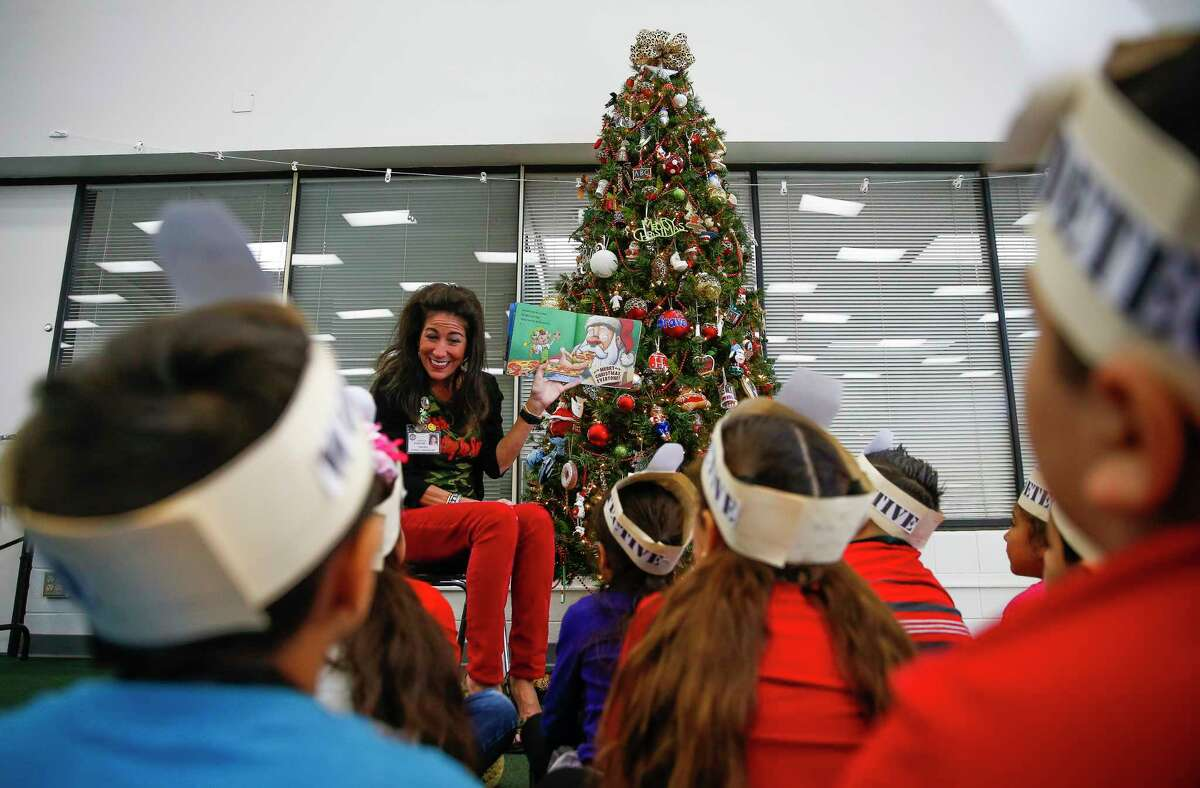 EDUCATION TEXAS RANK: 32, with 71 percent of fourth-graders scoring below proficient in reading levels. Above:Lieder Elementary School principal Karen Stockton reads a Christmas book to students in 2017.