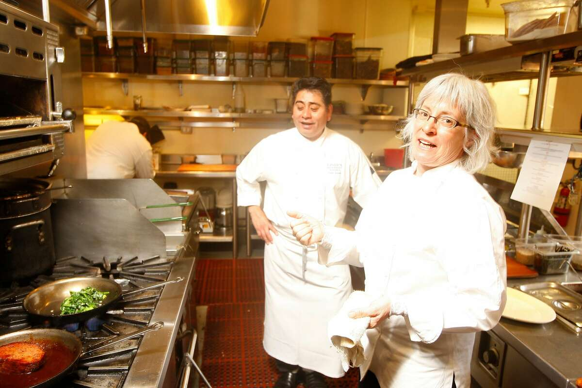 """Chef Cindy Pawlcyn making her """"Mighty Meatloaf"""" dish with Horseradish Barbeque sauce, along with chef Pablo Jacinto at Cindy's Backstreet Kitchen in St. Helena, Calif., on January 28, 2009."""