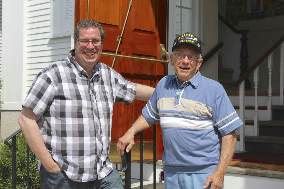 Korean War veteran Bernie Rotunda (right) from Bethel stands with Pastor John Parille (left) in front of Bethel United Methodist Church, one of the churches that will ring its bells 13 times at 2 p.m. on the Fourth of July. More than 20 churches across the Danbury area will ring their bells in a show of patriotism. Photo: Julia Perkins / Hearst Connecticut Media / The News-Times