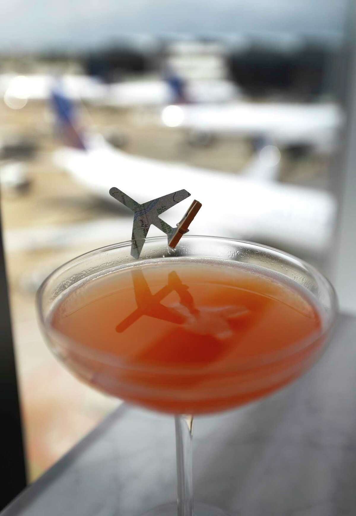 The Paper Airplane drink on display at the bar inside of the new United Polaris lounge at IAH airport, Tuesday, June 26, 2018, in Houston.