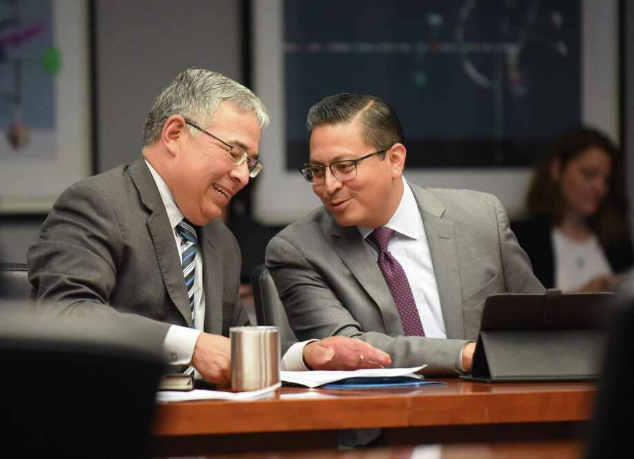City Attorney Andy Segovia (left) and Edward Guzman, deputy city attorney, talk after the meeting of City Council's Public Safety Committee on possible ways to reduce gun violence in San Antonio. Photo: Billy Calzada /San Antonio Express-News / San Antonio Express-News