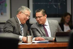 City Attorney Andy Segovia (left) and Edward Guzman, deputy city attorney, talk after the meeting of City Council's Public Safety Committee on possible ways to reduce gun violence in San Antonio.