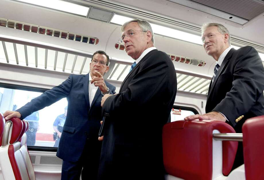 Connecticut Gov. Dannel P. Malloy, left, in July 2015 with James Redeker, commissioner of the Connecticut Department of Transportation, center; and John Hartwell of the CT Commuter Rail Council. Photo: Peter Hvizdak / New Haven Register / ©2015 Peter Hvizdak