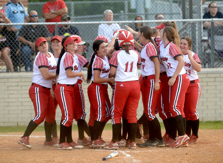 The Bridge City softball team celebrates after a home run during their first game of the regional quarterfinal playoffs at Port Arthur Memorial.