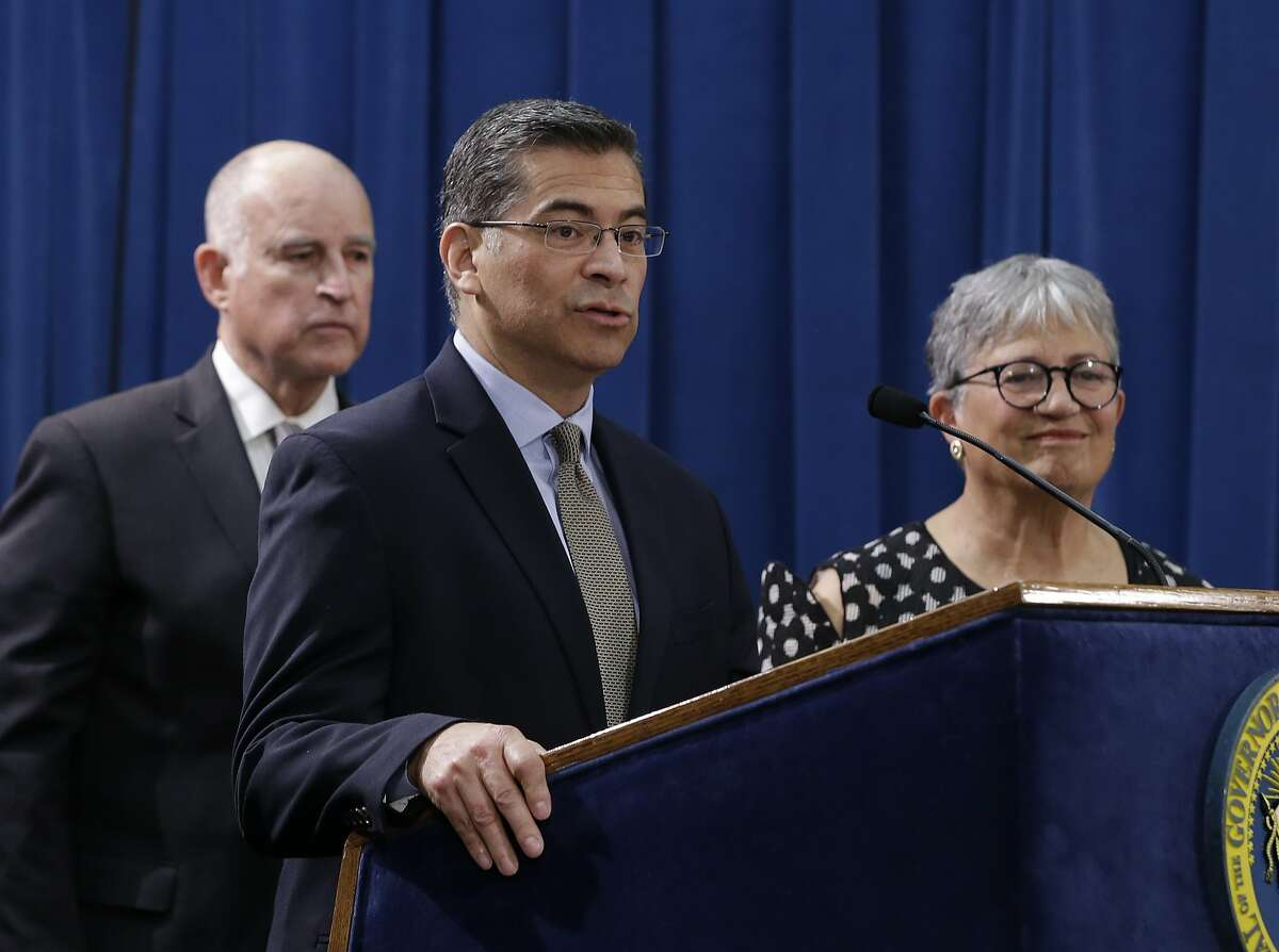 FILE - In this May 1, 2018, file photo, California Attorney General Xavier Becerra, center, speaks during a news conference in Sacramento, Calif. Insurance Commissioner Dave Jones has said he, too, would be eager to challenge President Donald Trump policies but says Becerra has been so focused on Trump that he is not doing enough on other issues, such as the opioid epidemic, gun violence and going after corporate polluters. Becerra says Jones is being deceptive, pointing to his office�s prosecutions for illegal gun possession, sex trafficking, embezzlement and other offenses. (AP Photo/Rich Pedroncelli, File)