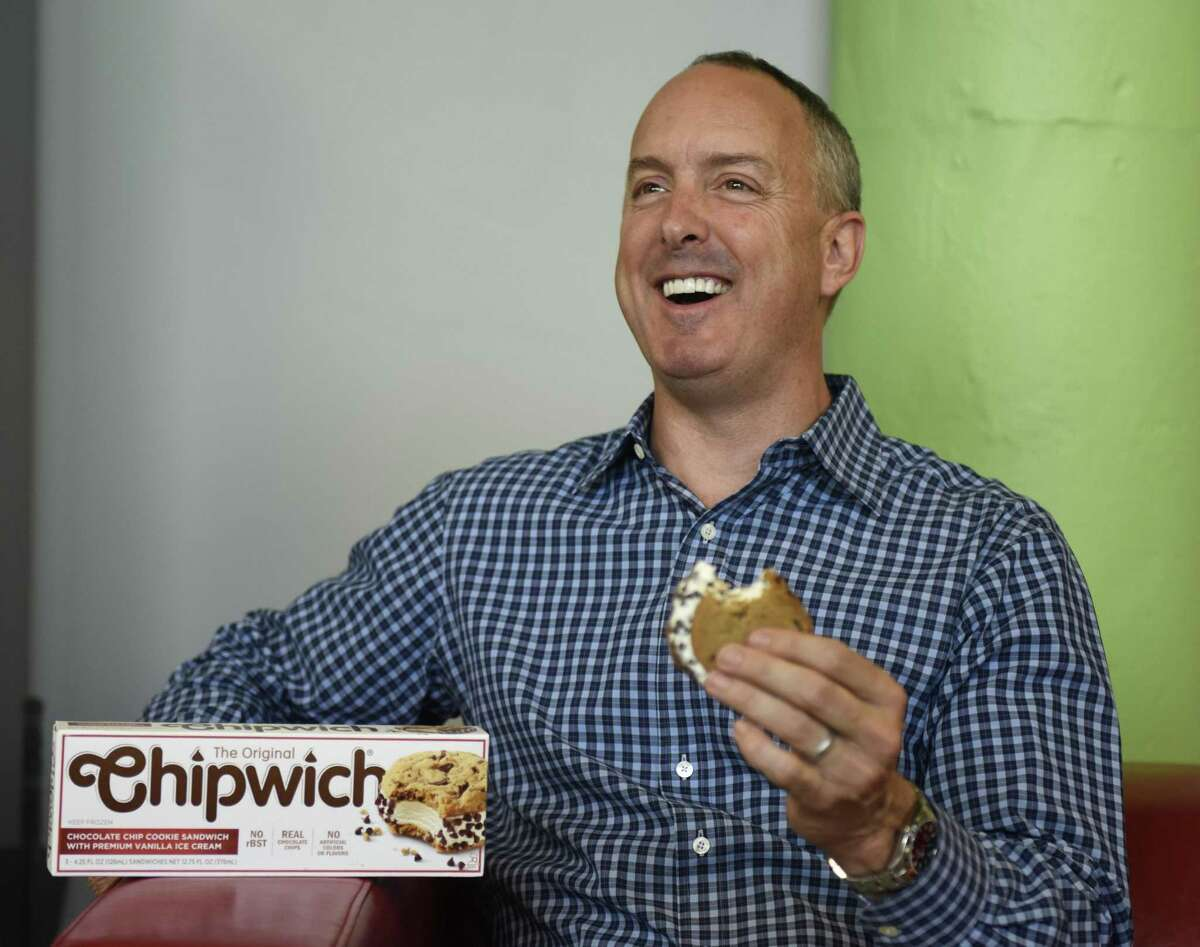 Crave Better Foods CEO David Clarke eats a Chipwich at the Comradity co-working space in Stamford, Conn. Tuesday, June 19, 2018. After a seven year hiatus, the classic ice cream cookie sandwich has returned after being acquired and relaunched by Crave Better Foods.