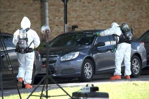<p>Hazardous material crews hepl investigate the scene where a fentanyl-laced flyer