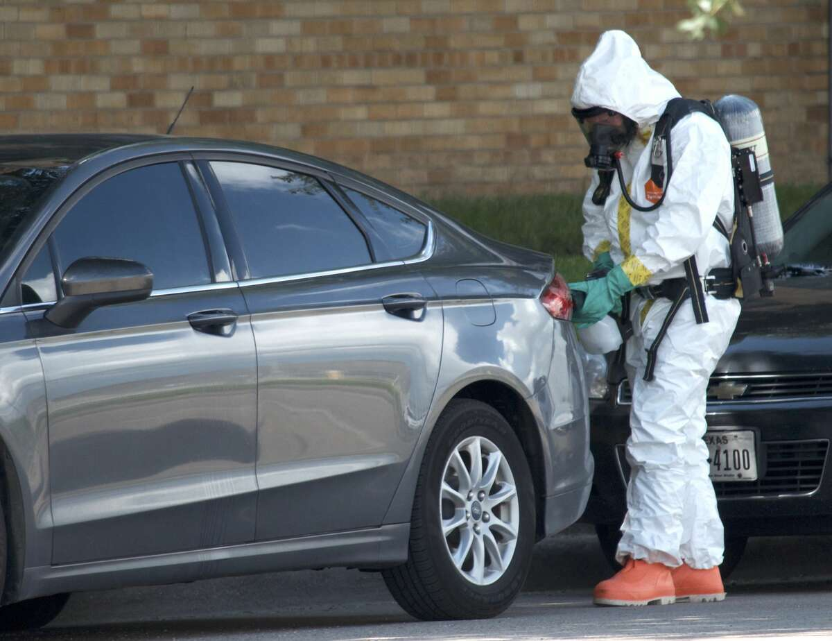 Hazardous material crews hepl investigate the scene where a fentanyl-laced flyer was found on the windshield of a Harris County Sheriff's Office vehicle Tuesday, June 26, 2018.