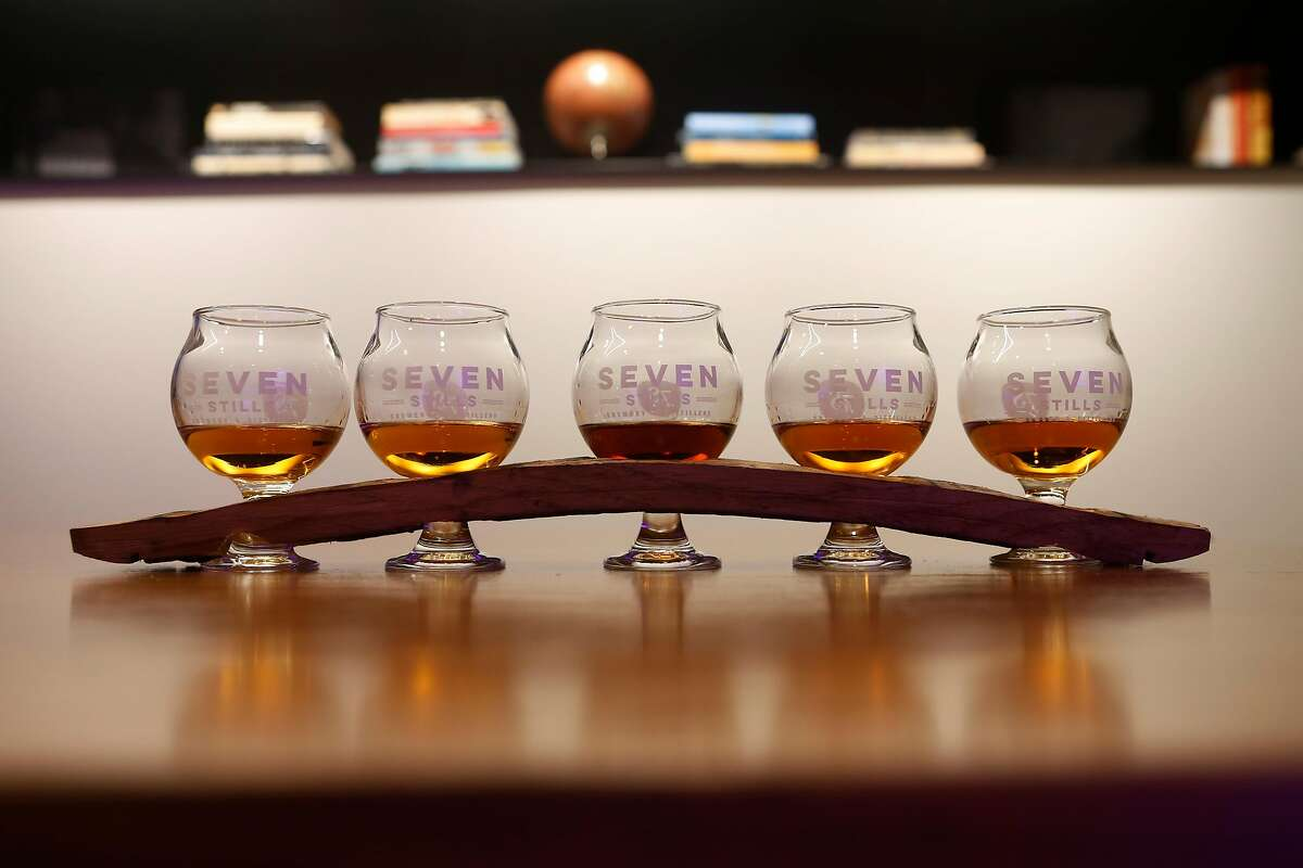 A whiskey flight, top, at Seven Stills' Nob Hill bar located inside the Stanford Court Hotel.
