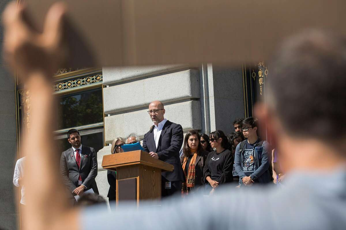 Dan Bernal, Chief of Staff - San Francisco for Congresswoman Nancy Pelosi, gives a speech outside San Francisco City Hall during press conference held to comment on the travel ban ruling on Tuesday, June 26, 2018 in San Francisco Calif. The Supreme Court has upheld President Donald Trump's travel ban.