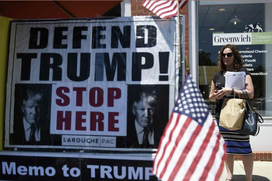 "Erica Fruin stops by the LaRouche PAC information stand set up near the U.S. Post Office in the Cos Cob section of Greenwich, Conn. Tuesday, June 26, 2018. The political action committee, named after Lyndon LaRouche, asks to end the ""coup"" against President Trump, support China's One Belt One Road Initiative, and support LaRouche's economic policies reinstating the Glass–Steagall banking separation act and returning to a national banking system. Photo: Tyler Sizemore / Hearst Connecticut Media / Greenwich Time"
