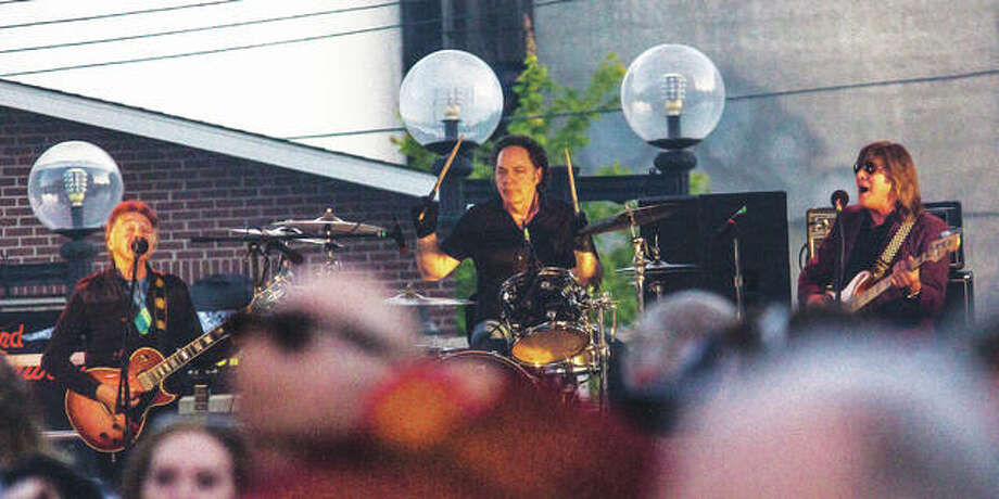 Rock band Badfinger plays to a large crowd at Mac's Downtown during the bar and restaurant's annual Kentucky Derby Street Party in 2017. Badfinger will return to Mac's to play Tuesday, July 3, before the city's Fourth of July celebration, Fireworks on the Mississippi, at Alton's Liberty Bank Amphitheater; Molly Hatchet will perform after the city's fireworks display at Mac's. Both bands will perform on the street outside Mac's. Photo:       Nathan Woodside|The Telegraph