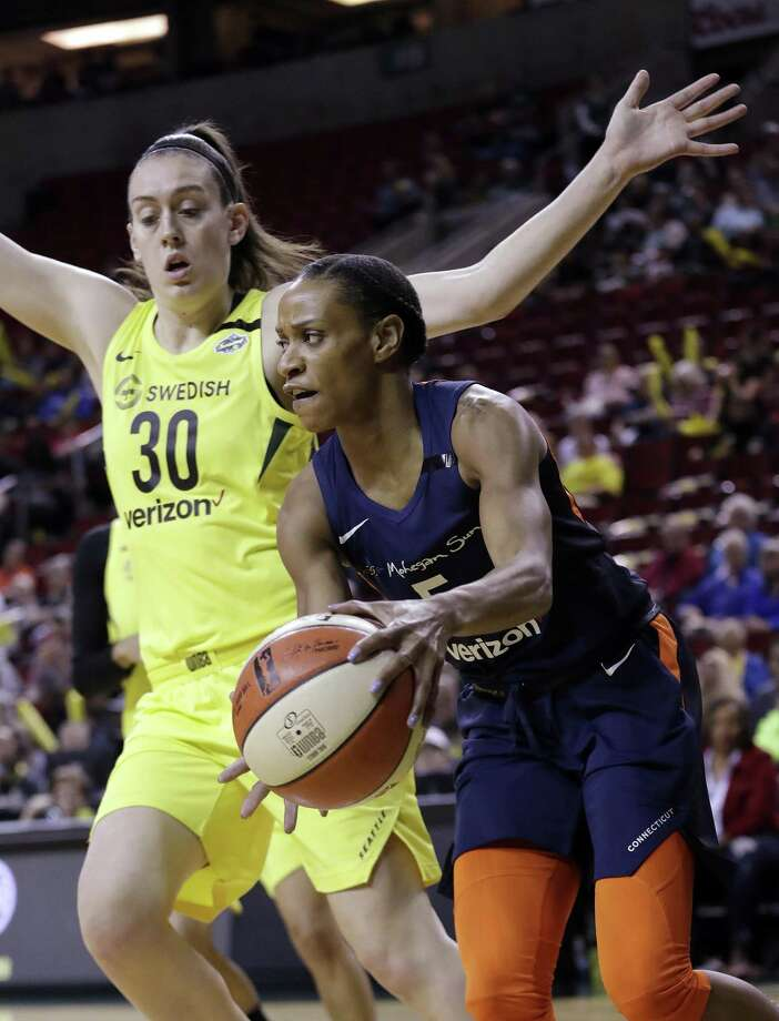 The Connecticut Sun's Jasmine Thomas, right, tries to drive past the Seattle Storm's Breanna Stewart during the first half on June 15. Photo: Elaine Thompson / Associated Press / Copyright 2018 The Associated Press. All rights reserved.