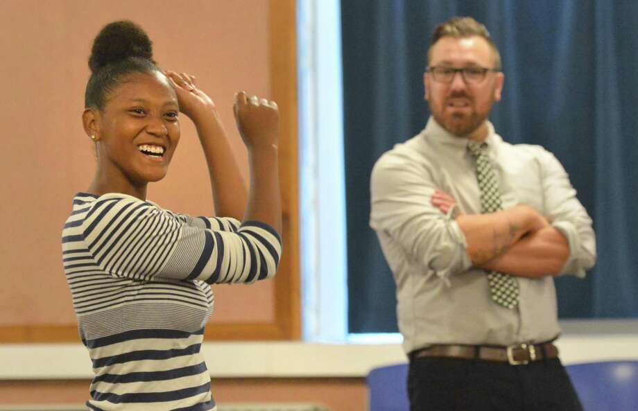 Strive facilitator Stephen Rilling watches as Autumn Joseph tries to remember the names and the move each member of the Mayors summer employment program made during a Strive program meet and greet at City Hall on Tuesday June 26, 2018 in Norwalk Conn. During the meet and greet they got to know each other by each person assigning a physical move to the syllables in their first name and then all repeat it while going around the room to everyone. Photo: Alex Von Kleydorff / Hearst Connecticut Media / Norwalk Hour