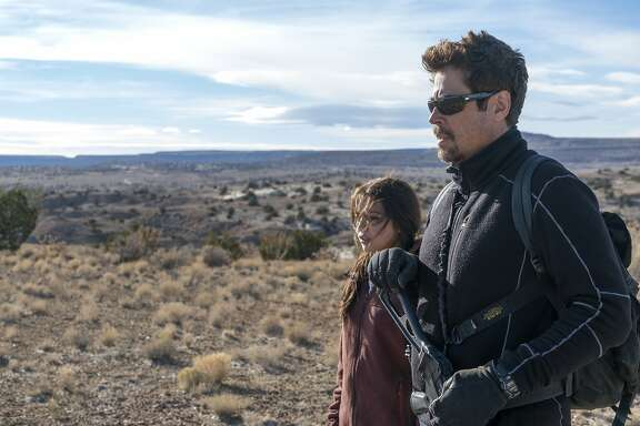 """This image released by Sony Pictures shows Benicio Del Toro, right, and Isabela Moner in """"Sicario: Day of the Soldado."""" (Richard Foreman, Jr./Sony Pictures via AP)"""