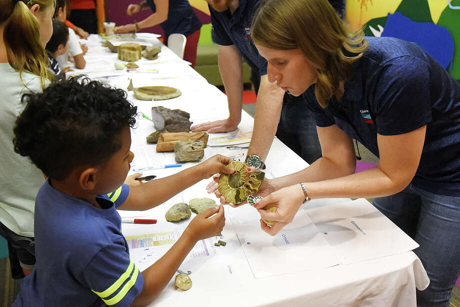 Volunteers from Chevron hosted a kids geology class June 26, 2018 at Midland County Public Library Centennial Branch.  James Durbin/Reporter-Telegram Photo: James Durbin / © 2018 Midland Reporter-Telegram. All Rights Reserved.