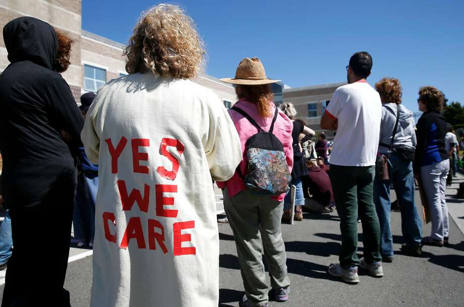 Roz Sarah wears alters her coat to counter First Lady Melania Trump�s fashion statement at an immigrants rights  march and rally in front of the West County Detention Facility in Richmond, Calif. on Tuesday, June 26, 2018. Demonstrators say ICE authorities are detaining as many as 200 immigrants daily at the facility. Photo: Paul Chinn, The Chronicle