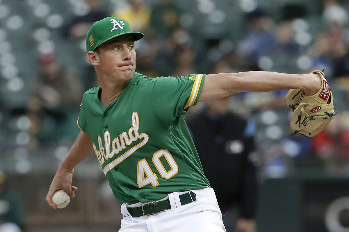 Oakland Athletics pitcher Chris Bassitt throws against the Los Angeles Angels during the first inning of a baseball game in Oakland, Calif., Friday, June 15, 2018. (AP Photo/Jeff Chiu)