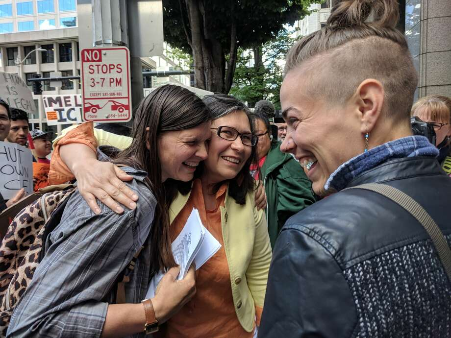 Maru Mora-Villalpando, center, hugs and greets her supporters before her immigration hearing June 26 in downtown Seattle. Photo: Lynsi Burton/SeattlePI