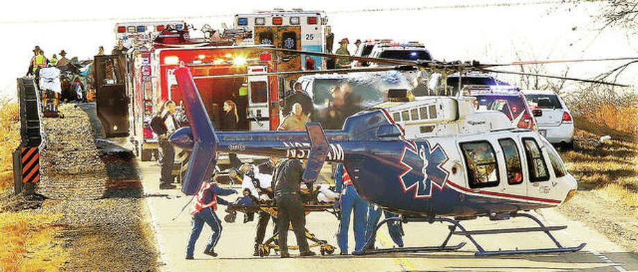 In this file photo, ARCH Air Medical Services Inc. flight nurses load a Pontoon Beach Police officer, Lee Brousseau, of Bethalto, into a helicopter to be airlifted to St. Louis Thursday morning after his police car collided with a pickup truck, which burst into flames, killing Daniel Bell, the pickup truck driver.