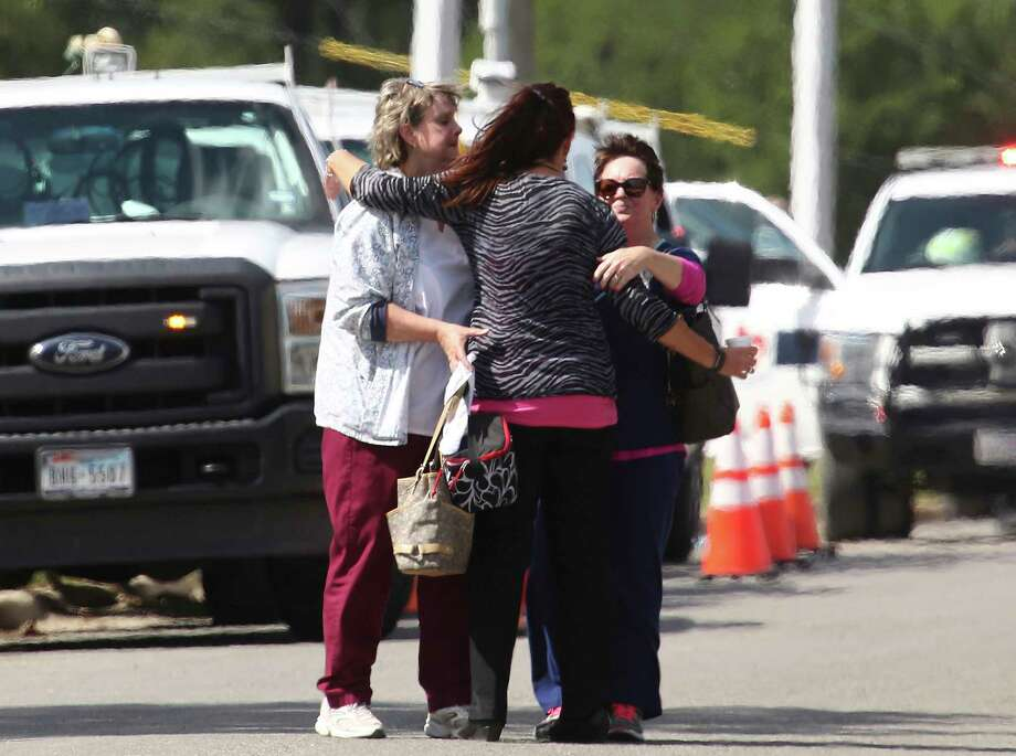 People hug near Coryell Memorial Healthcare System hospital where an explosion in a building under construction injured several people, and knocked power out for a large portion of the city, Tuesday, June 26, 2018, in Gatesville, Texas. (Rod Aydelotte/Waco Tribune-Herald via AP) Photo: Rod Aydelotte, Associated Press / Waco Tribune-Herald