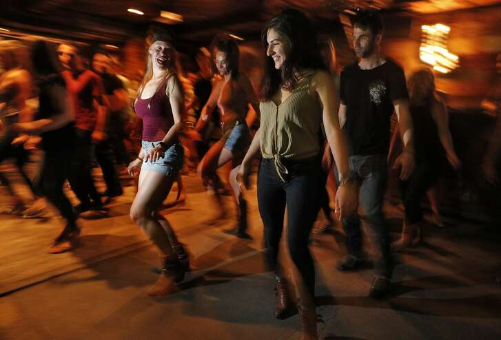 Patrons dance during weekly line dancing lessons at Jaxson, a bar in the Marina that specializes in country music, in San Francisco, Calif., on Sunday, June 24, 2018.