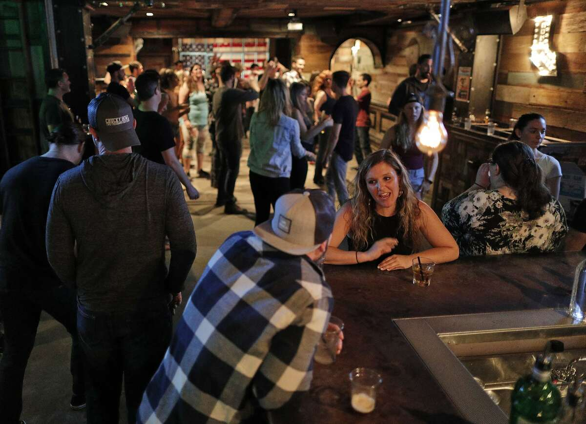 Patrons enjoy their drinks at the bar during weekly line dancing lessons at Jaxson, a bar in the Marina that specializes in country music, in San Francisco, Calif., on Sunday, June 24, 2018.