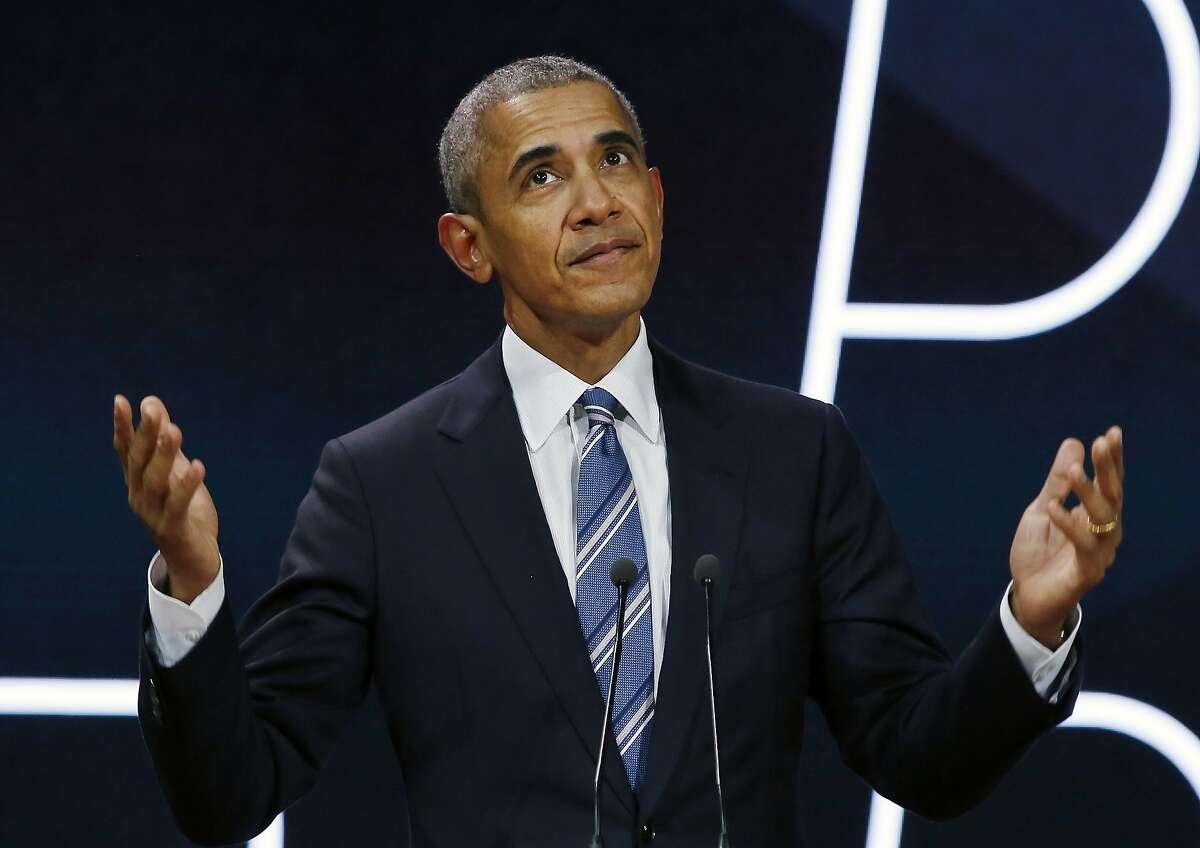 FILE-- Former President Barack Obama delivering a speech in Paris in December.