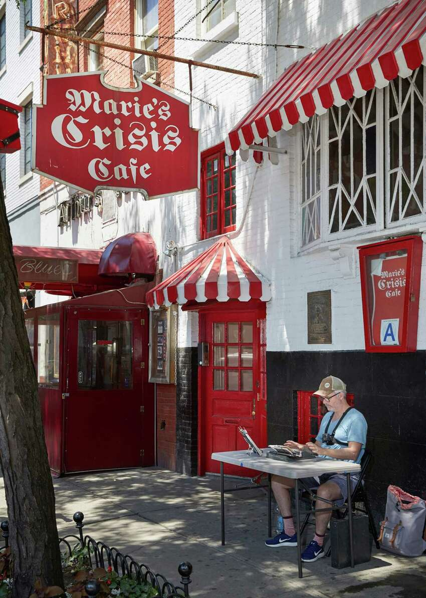 Tim Youd retyping Patricia Highsmith's The Talented Mr. Ripley in front of Marie's Crisis in Greenwich Village, New York City (Provided photo)