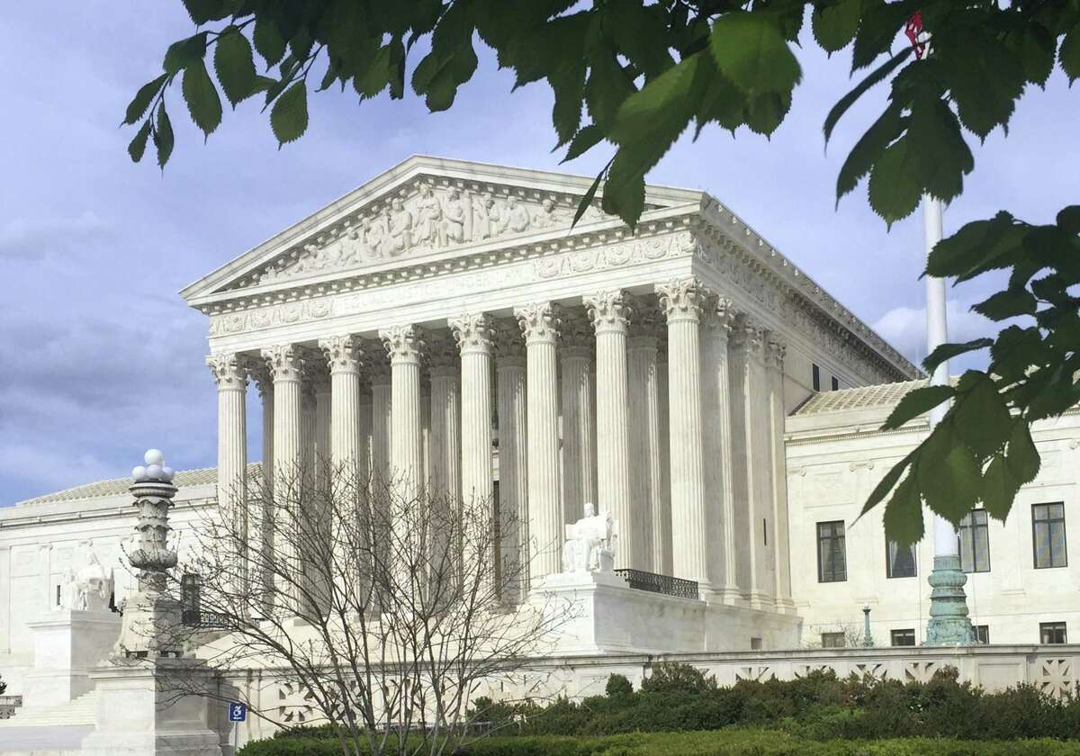 The Supreme Court says government workers cannot be forced to contribute to labor unions that represent them in collective bargaining, dealing a serious financial blow to organized labor.