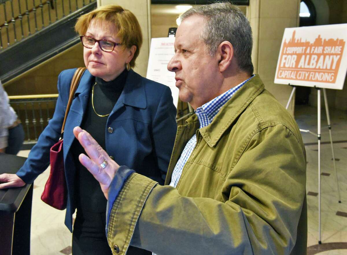 Council members Judy Doesschate, left, and Richard Conti during a City Hall news conference outlining an advocacy campaign for Capital City Funding Thursday, Feb. 23, 2017 in Albany, NY. (John Carl D'Annibale / Times Union)