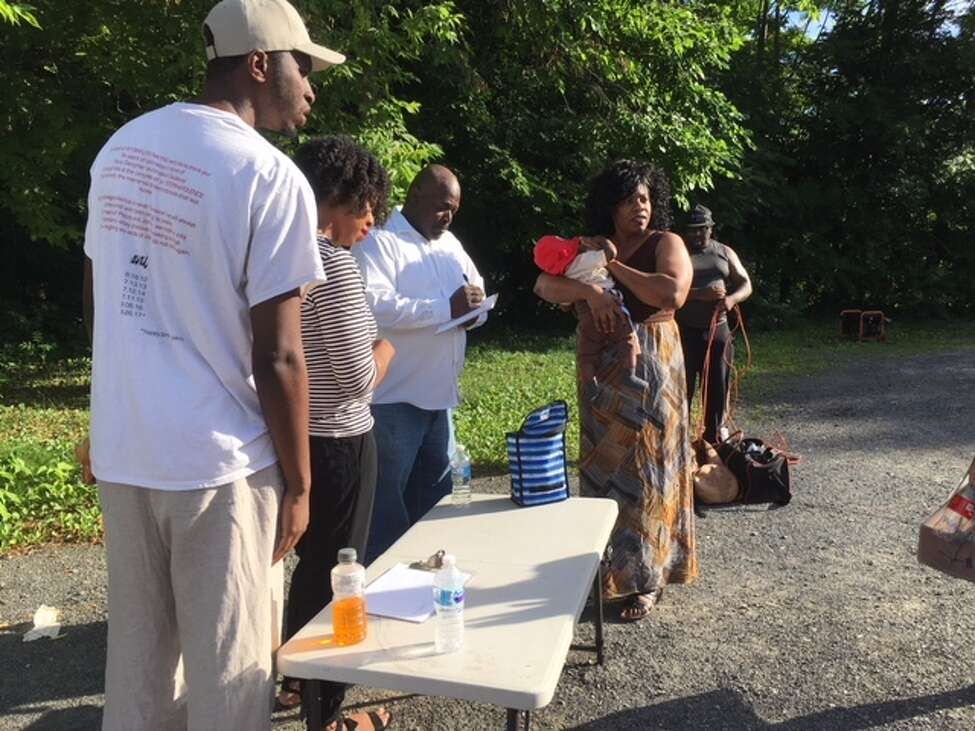 Community activist Sam Coleman signs up Arbor Hill and West Hill residents to help save the neighborhood from drugs and violence.
