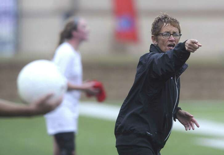 Reagan soccer coach Frankie Whitlock asks for clarification from an official during girls UIL Class 5A state semifinal soccer action against West Plano in Georgetown on Thursday, April 17, 2014.