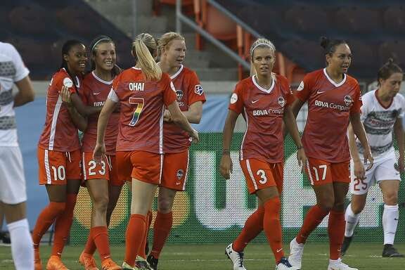 Houston Dash players gather to celebrate Sofia Huerta's goal against the Portland Thorns FC during the first half of the NWSL game at BBVA Compass Stadium on Friday, June 22, 2018, in Houston. ( Yi-Chin Lee / Houston Chronicle )